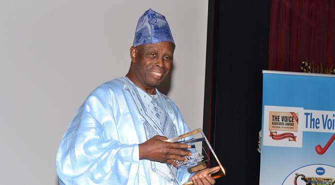 Apostle Alile with his award in Holland