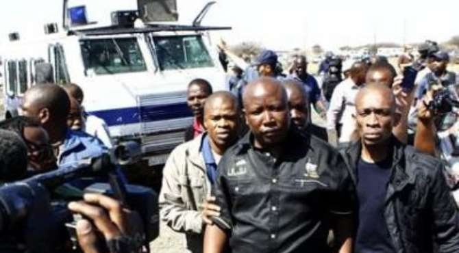 EXPELLED ANCYL PRESIDENT JULIUS MALEMA (C) LEAVES AFTER ARGUING WITH POLICE IN MARIKANA, NEAR RUSTENBURG, SOUTH AFRICA'S NORTH WEST PROVINCE, SEPTEMBER 17, 2012.