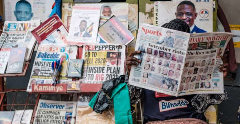 Newspapers covering upcoming elections are seen in Kampala, Uganda, on January 4, 2021. Security forces have harassed and detained journalists covering opposition candidates in the election. (AFP/Sumy Sadurni)
