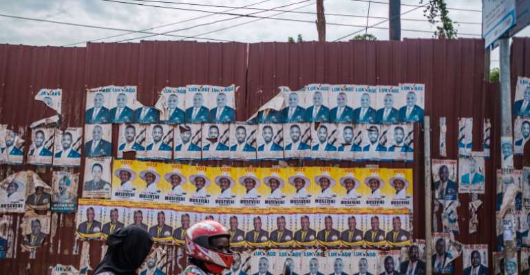 Candidate posters are seen in Kampala, Uganda, on January 6, 2021. CPJ joined a letter to the country's president today urging the government to maintain internet access through the election. (AFP/Sumy Sadurni)