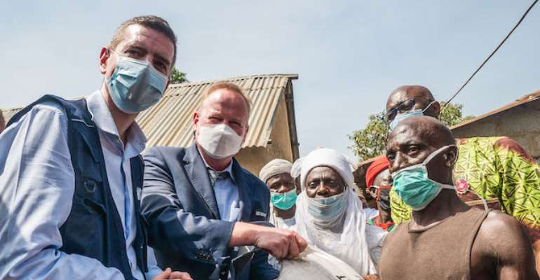 Mr. Paul Howe (L), Country Director of WFP, is joined by the Deputy Ambassador of Switzerland, Mr. Lukas Schifferle, and the Emir of Garki, HRH, in Karmajiji Abuja, Nigeria on November 20th, 2020. WFP Nigeria is supporting Nigeria's growing hunger needs b