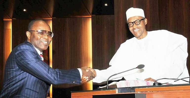 Minister of State for Petroleum, Dr Ibe Kachikwu with President Muhammadu Buhari at the State House recently