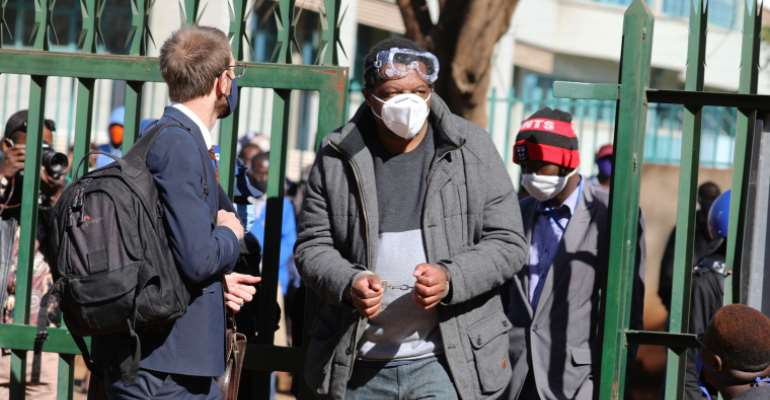 Journalist Hopewell Chin'ono is seen at a court in Harare, Zimbabwe, on July 22, 2020. Today, he was rearrested after he was released on bail. (AP/Tsvangirayi Mukwazhi)