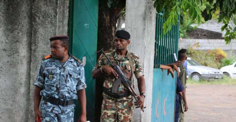 Soldiers are seen in Moroni, Comoros, on April 2, 2019. Authorities recently detained two journalists over their coverage of protests in the city. (AFP/Youssouf Ibrahim)