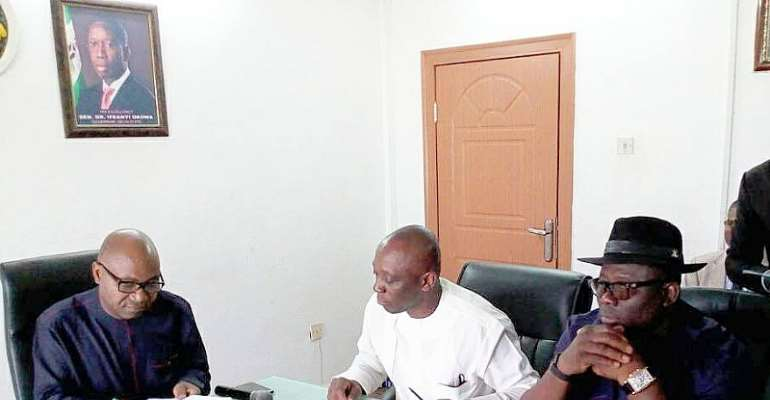 L-R Secretary to Delta State Government, Hon Ovie Agas signing the MOU on-behalf of Delta State Government while Delta Attorney General and Commissioner for Justice, Hon Peter Mrakpor (in white) and member representing Okpe Constituency at the State House