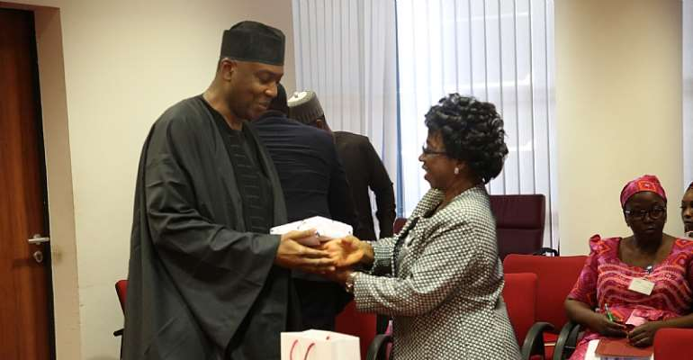 Senate President giving the leader of the QCOGA delegation, National President, Dr. Frances Funmi Ajose, a souvenir from the office.