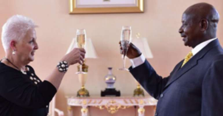 Photo Caption : Champagne toast. U.S. Ambassador to Uganda Deborah Malac and dictator Museveni. This is when she presented her credentials to Museveni in 2015 as reported in The New Vision. Photo: Uganda's Presidential Press Unit.