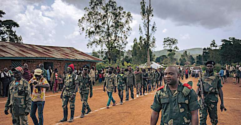 Soldiers and militia members are seen in Ituri province, Democratic Republic of Congo, on September 19, 2020. Unidentified men in military uniform recently threatened to kill journalist Parfait Katoto in Ituri. (AFP/Alexis Huget)