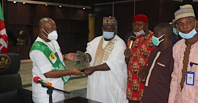 Governor Hope Uzodimma receives an award as Pan-Nigerian Governor of the Year.