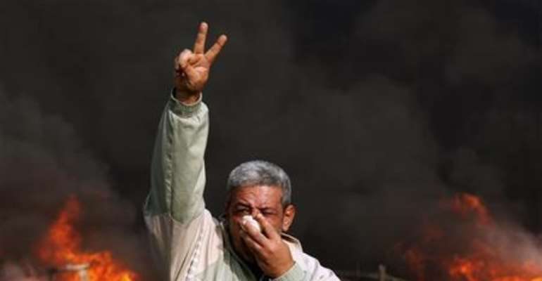AN EGYPTIAN PROTESTER. PHOTOGRAPH BY REUTERS.