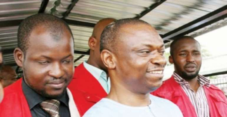 PHOTO: MR FRANCIS ATUCHE GUARDED BY OPERATIVES OF THE EFCC DURING HIS ARRAIGMENT FOR VARIOUS FINANCIAL CRIMES.