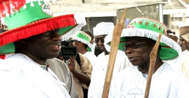 R-L: PRESIDENT GOODLUCK EBELE JONATHAN AND FORMER PRESIDENT OLUSEGUN OBASANJO AT THE PDP PRESIDENTIAL RALLY IN LAGOS TODAY, MARCH 01, 2011.