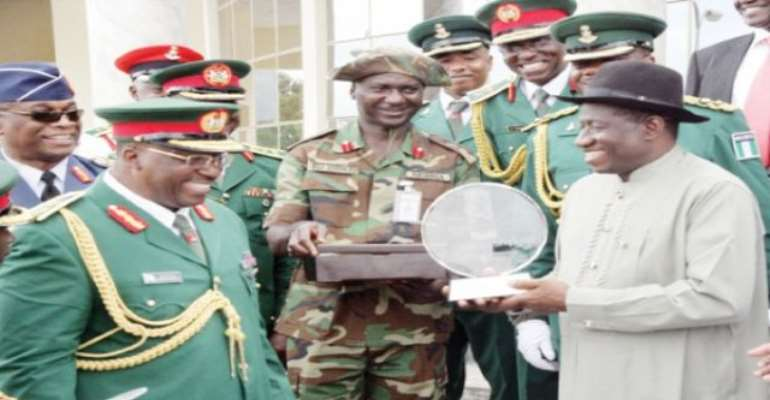 PHOTO: A FILE PHOTO SHOWING PRESIDENT GOODLUCK JONATHAN RECEIVING A PLAQUE FROM THE CHIEF OF ARMY STAFF, LT. GENERAL ABDULRAHAMAN DAMBAZAU. PHOTO: NAN.