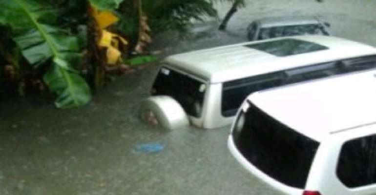 TWO SUVS SUBMERGED IN THE LAGOS FLOOD.