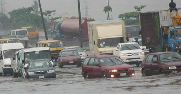 Vehicles wade through the flooded Apapa-Oshodi expressway from Sanya Bus Stop to Mi le 2, yesterday. The 5-minute journey now takes over three hours. Photo: Bunmi Azeez.
