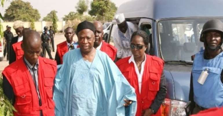 PHOTO: ABDULLAHI ADAMU BEING ESCORTED BY OPERATIVES OF THE EFCC TO COURT.