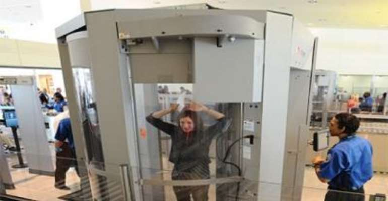 PHOTO: A TRAVELLER IN A SCREENING MACHINE AT A US AIRPORT.