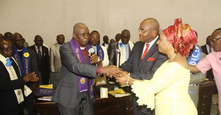 A'Ibom SSG Mr Udom Emmanuel and Wife Martha(R), receiving an excellence award from the fmr Nat'l chairman of Qua Iboe Church, Dr Emmanuel Ossom(L)