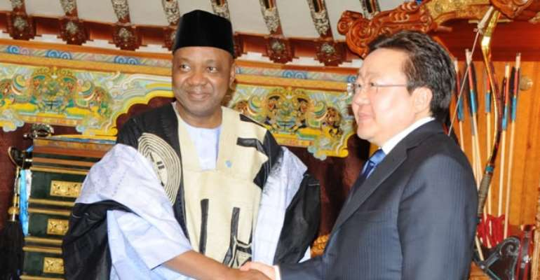 VP NAMADI SAMBO IN A HANDSHAKE WITH PRESIDENT OF MONGOLIA ELBEGDORJ TSAKHIA DURING THE 7th SESSION CONFERENCE OF COMMUNITY FOR DEMOCRACIES AT ULAANBAATAR, MONGOLIA. APRIL 29, 2013