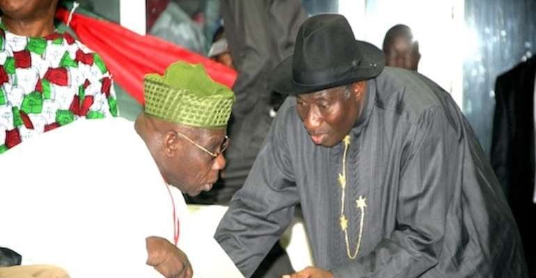PRESIDENT GOODLUCK EBELE JONATHAN (R) STRATEGISES WITH FORMER PRESIDENT OLUSEGUN OBASANJO AT THE PDP'S PRESIDENTIAL CONVENTION IN ABUJA A FEW WEEKS AGO.