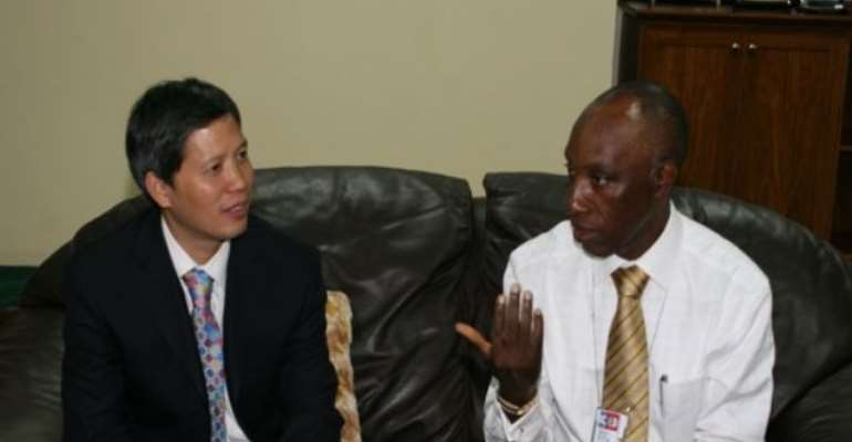PHOTO: R-L: GMD, NNPC, ENGR AUSTEN ONIWON AND MANAGING DIRECTOR, ADDAX PETROLEUM DEV. NIGERIA, MR PHILIP (XINMIN)WU DISCUSSING AREAS OF COLLABORATION AT THE NNPC TOWERS IN ABUJA TODAY, JULY12, 2010.