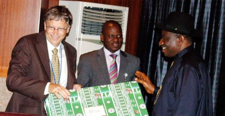 R-L: PRESIDENT GOODLUCK EBELE JONATHAN PRESENTS A GIFT TO VISITING CHAIRMAN OF MICROSOFT AND THE BILL AND MELLINDA GATES FOUNDATION, MR BILL GATES, INSIDE THE PRESIDENTIAL VILLA, ABUJA, THURSDAY, SEPTEMBER 29, 2011.