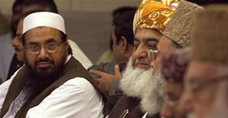 HAFIZ SAEED (L), THE HEAD OF JAMAAT-UD-DAWA AND FOUNDER OF LASHKAR-E-TAIBA, ATTENDS A CONFERENCE FOR ''SAFEGUARDING THE HONOUR OF THE PROPHET MOHAMMAD'', WITH OTHER POLITICAL AND RELIGIOUS LEADERS IN ISLAMABAD SEPTEMBER 26, 2012.