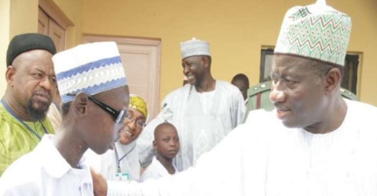 PHOTO: NIGERIAN PRESIDENT GOODLUCK JONATHAN ENGAGES A BLIND STUDENT AT THE SCHOOL FOR SPECIAL EDUCATION DURING HIS ONE-DAY VISIT TO ZAMFARA STATE TODAY. IMAGE: STATE HOUSE.