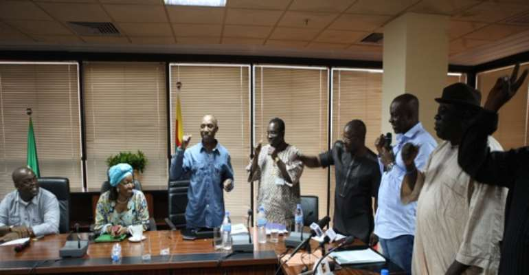 OIL WORKERS' UNION REPRESENTATIVES WITH REPRESENTATIVES OF THE FEDERAL GOVERNMENT INSIDE THE MEETING AT THE OFFICE OF THE MINISTER OF PETROLEUM RESOURCES IN ABUJA ON SATURDAY, JULY 23, 2011.