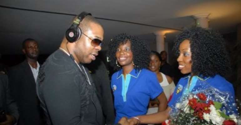 Hostesses welcome Busta Rhymes to Nigeria last Tuesday....