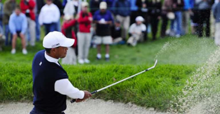 TIGER WOODS: SUFFERED BUNKER TROUBLE AT THE SECOND HOLE WHICH LED TO A BOGEY