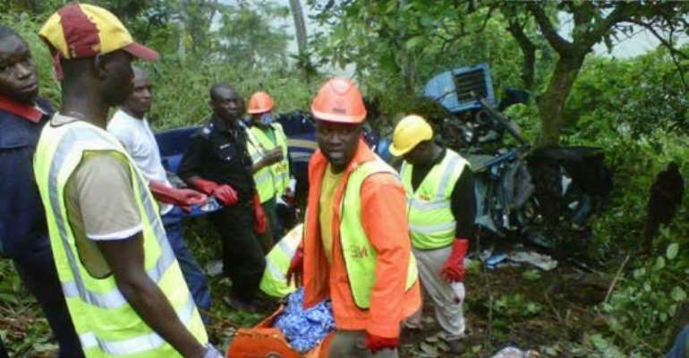 RESCUE OFFICIALS AT THE SCENE OF THE FATAL CHOPPER CRASH.