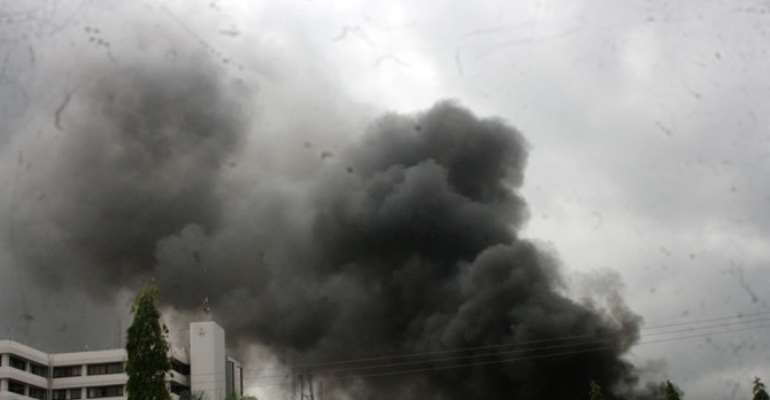 BILLOWS OF SMOKE AT THE POLICE FORCE HEADQUARTERS AFTER A BOKO HARAM SPONSORED BOMB ATTACK IN ABUJA ON JUNE 16, 2011.