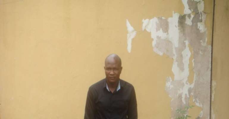 PHOTO: MR VINCENT BULUS AT THE SSS OFFICE IN JOS, PLATEAU STATE.