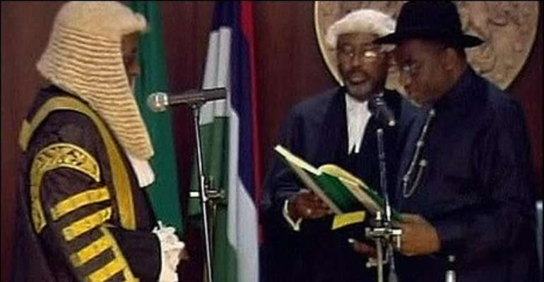 Nigeria's acting President Goodluck Jonathan is sworn in as head of state following the death of President Umaru Yar'Adua.