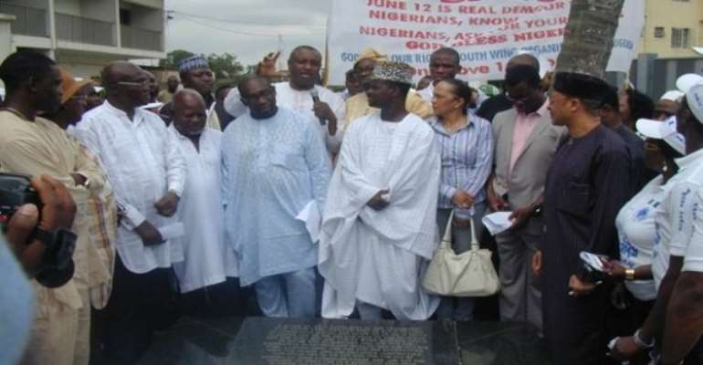 PHOTO: PRO-JUNE 12 ACTIVISTS INCLUDING PROFESSOR PATRICK UTOMI, MR DELE MOMODU AND MR. FESTUS KEYAMO AT THE GRAVESIDE OF LATE CHIEF MOSHOOD OLAWALE ABIOLA, THE PRESUMED WINNER OF THE JUNE 12, 1993 PRESIDENTIAL ELECTION.