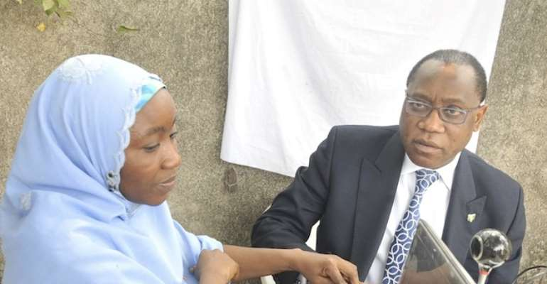 FINANCE MINISTER, DR OLUSEGUN AGANGA (R) WITH AN INEC OFFICIAL DURING HIS REGISTRATION TO VOTE AT THE WEEKEND IN PARK VIEW, IKOYI, LAGOS.