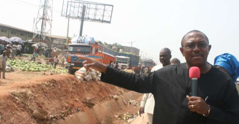 Gov. Peter Obi at the Bridge Head axis of Onitsha-Enugu Dual Carriage way shortly before he announced the shutting down of all-
