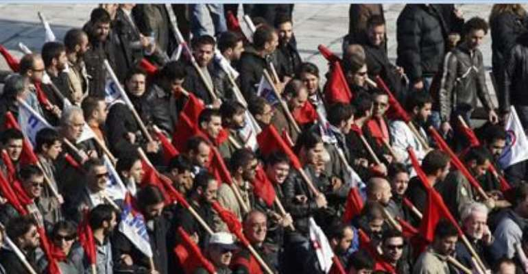 PROTESTERS FROM THE COMMUNIST-AFFILIATED TRADE UNION PAME MARCH DURING A RALLY IN FRONT OF THE PARLIAMENT DECEMBER 1, 2011.