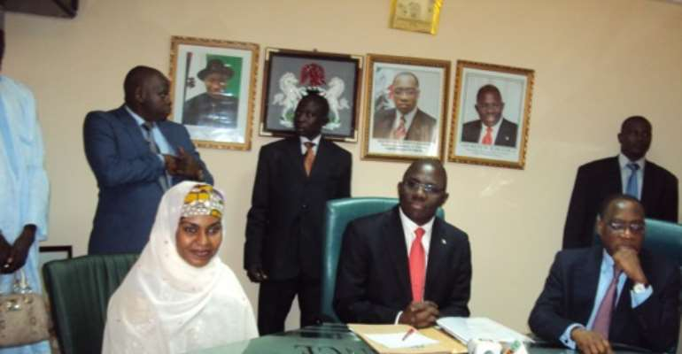 PHOTO: NEW MINISTER OF STATE FOR FINANCE, HAJIA YABAWA LAWAN WABI (L); MR. REMI BABALOLA (M) AND FINANCE MINISTER, MR OLUSEGUN AGANGA DURING THE HANDOVER CEREMONY AT THE MINISTRY OF FINANCE TODAY, AUGUST 11, 2010.