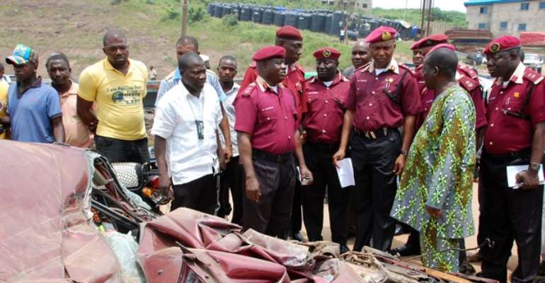 ROAD SAFETY BOSS OSITA CHIDOKA ALONGSIDE OFFICIALS OF THE FEDERAL ROAD SAFETY COMMISSION INSPECTING THE SCENE OF A MULTIPLE AUTO CRASH WHERE MANY DIED IN KUGBO, ABUJA TWO DAYS AGO.