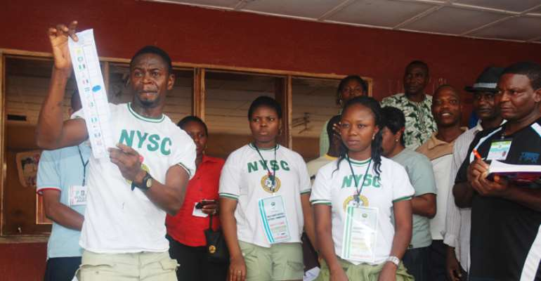 NYSC PERSONNEL DEPLOYED BY INEC DURING THE DELTA STATE GOVERNORSHIP RERUN ELECTION COUNT VOTES IN ASABA, STATE CAPITAL.