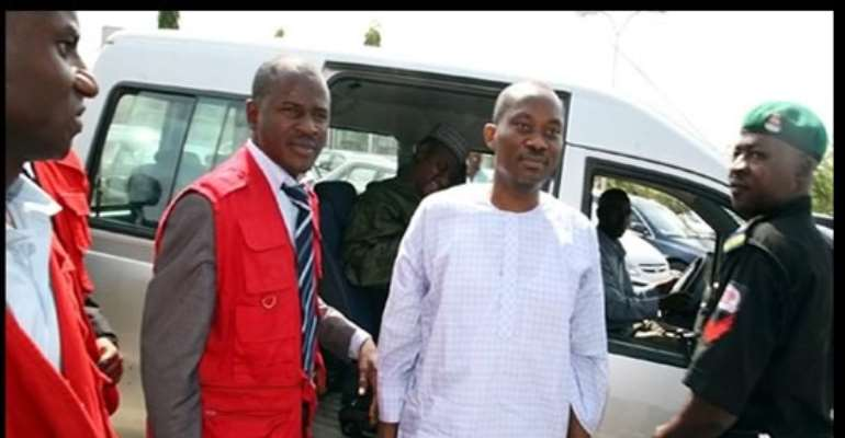 PHOTO: HONOURABLE NDUDI ELUMELU BEING ESCORTED TO COURT BY EFCC OPERATIVES AFTER HIS ARREST.