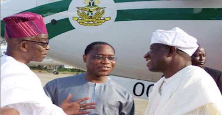 R-L: PRESIDENT GOODLUCK JONATHAN IS RECEIVED AT THE PRESIDENTIAL WING OF THE MURTALA MUHAMMED AIRPORT IKEJA, LAGOS, BY FINANCE MINISTER, DR OLUSEGUN AGANGA (M) AND MINISTER OF COMMERCE AND INDUSTRY, SENATOR JUBRIL MARTINS-KUYE, TODAY, MARCH 20, 2011.