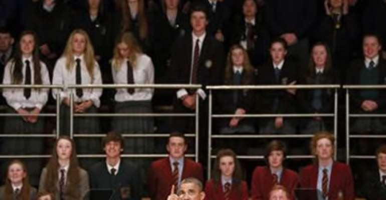 U.S. PRESIDENT BARACK OBAMA SPEAKS TO GUESTS AT THE WATERFRONT HALL IN BELFAST JUNE 17, 2013.