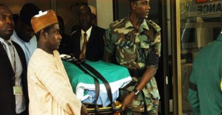 PHOTO: THE BODY OF LATE PRESIDENT UMARU YAR'ADUA BEING TAKEN OUT OF THE VILLA FOR BURIAL RITES AND FUNERAL IN KATSINA.