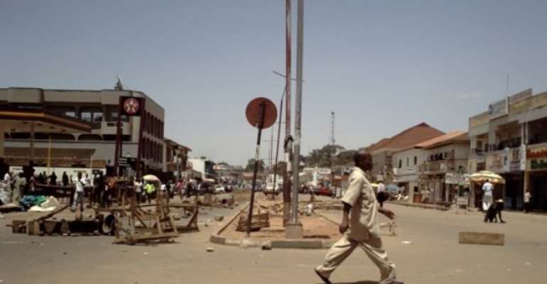 PHOTO: A DESERTED JOS STREET TODAY DURING THE CONFRONTATION BETWEEN OPERATIVES AND MOTORCYCLE RIDERS.