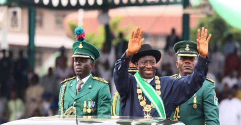 PRESIDENT GOODLUCK EBELE JONATHAN SALUTES SPECTATORS AFTER HIS SWEARING-IN AT THE EAGLE SQUARE ABUJA ON MAY 29, 2011.