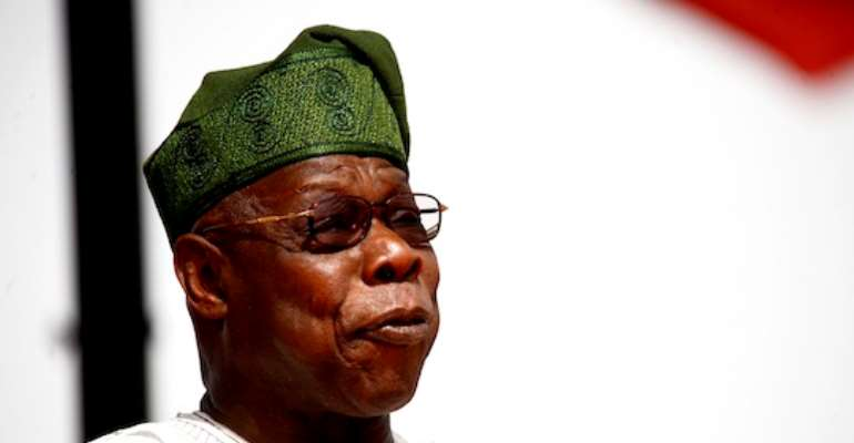 FORMER PRESIDENT OLUSEGUN OBASANJO ADDRESSING PDP SUPPORTERS AT THE GRAND FINALE RALLY OF THE PDP IN  ABUJA TODAY, MARCH 26, 2011.
