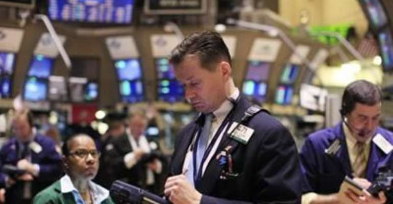 TRADERS WORK ON THE FLOOR OF THE NEW YORK STOCK EXCHANGE, AUGUST 16, 2011.
